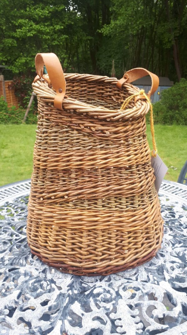 Asymetric leather side handled basket
