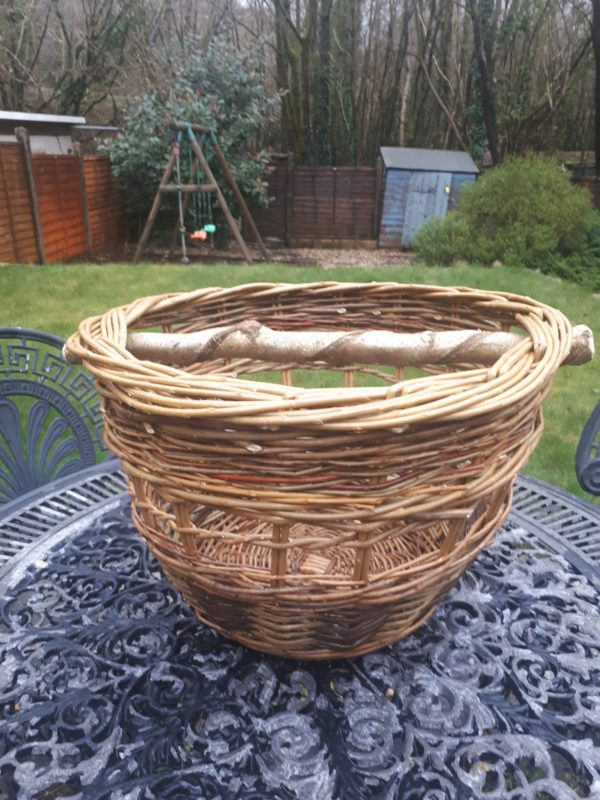 Open sided basket with twisted hazel handle